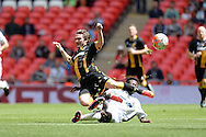Hereford FC Sirdic Grant makes a tackle during the FA Vase match between Hereford FC  and Morpeth Town at Wembley Stadium, London, England on 22 May 2016. Photo by Dennis Goodwin.