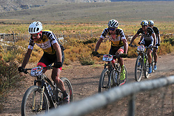 ROBERTSON, SOUTH AFRICA - MARCH 19: Yellow jersey wearers Nicola Rohrbach and Daniel Geismayr ahead of Simon Stiebjahn and Tim Boehme during stage one's 110km from Robertson on March 19, 2018 in Cape Town, South Africa. Mountain bikers from across South Africa and internationally gather to compete in the 2018 ABSA Cape Epic, racing 8 days and 658km across the Western Cape with an accumulated 13 530m of climbing ascent, often referred to as the 'untamed race' the Cape Epic is said to be the toughest mountain bike event in the world. (Photo by Dino Lloyd)