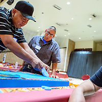 082114       Cable Hoover<br /> <br /> Leander Vicenti, left, helps Adrian Dubois, center, work on his portrait collage during the Shining Star event at Red Rock Park Thursday.