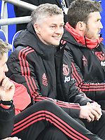 Football - 2018 / 2019 Premier League - Cardiff City vs. Manchester United<br /> <br /> Manchester Utd caretaker manager Ole Gunnar Solskjaer in his 1st game in charge, smiles  on the bench at Cardiff City Stadium.<br /> <br /> COLORSPORT/WINSTON BYNORTH