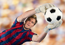Soccer player catching ball in air (Credit Image: © Image Source/Pete Saloutos/Image Source/ZUMAPRESS.com)