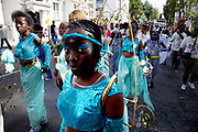 Costumed dancer at the Notting Hill Carnival in West London. The Notting Hill Carnival is an annual event which since 1964 has taken place each August, over two days (the August bank holiday Monday and the day beforehand). It is led by members of the West Indian / Caribbrean community, particularly the Trinidadian and Tobagonian British population, many of whom have lived in the area since the 1950s. The carnival has attracted up to 2 million people in the past, making it the second largest street festival in the world. The celebration centres around a parade of floats, dancers and sound systems.