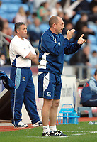 Photo: Ed Godden.<br />Coventry City v Plymouth Argyle. Coca Cola Championship. 30/09/2006. Plymouth Manager Ian Holloway applauds his teams performance, while Coventry Manager Micky Adams (L) watches his team go a goal down.