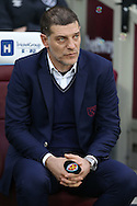 Slaven Bilic, the West Ham United manager looking on from his seat in the dugout. Premier league match, West Ham Utd v Hull city at the London Stadium, Queen Elizabeth Olympic Park in London on Saturday 17th December 2016.<br /> pic by John Patrick Fletcher, Andrew Orchard sports photography.