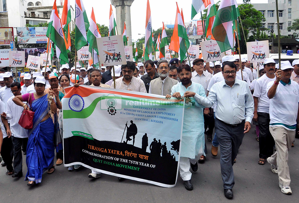 August 29, 2017 - Kolkata, West Bengal, India - Union Minister of State Urban Development, Housing, Babul Supriyo(in middle) with Central Government employees participate in the Triranga Yatra rally in Kolkata. Central Government employees participate in a rally called Triranga Yatra to celebrate 75th years of Quit India Movement in Kolkata on Aug 29, 2017 (Credit Image: © Saikat Paul/Pacific Press via ZUMA Wire)