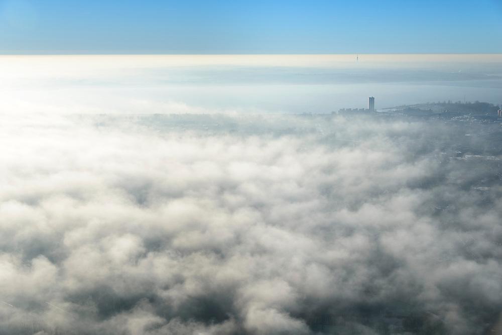 Nederland, Flevoland, Almere, 11-12-2013; Almere Poort in de mist, TV mast Hilversum in de achtergrond.<br /> Newly constructed city of Almere in the fog.<br /> luchtfoto (toeslag op standaard tarieven);<br /> aerial photo (additional fee required);<br /> copyright foto/photo Siebe Swart.