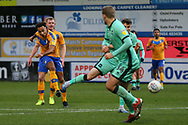 Mansfield Town forward Nicky Maynard (11) shoots and scores his second goal go the game during the EFL Sky Bet League 2 match between Mansfield Town and Carlisle United at the One Call Stadium, Mansfield, England on 1 February 2020.
