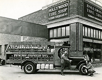 1930 Vern Farquhar (kneeling) at his Hollywood Tire Shop at 6472 Sunset Blvd. before his Wilcox Ave. location was built.
