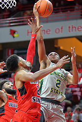 NORMAL, IL - November 13: Delshon Strickland looks for a bucket defended by Zach Copeland and Keyshawn Evans  during a college basketball game between the ISU Redbirds  and the Chicago State Cougars on November 13 2018 at Redbird Arena in Normal, IL. (Photo by Alan Look)