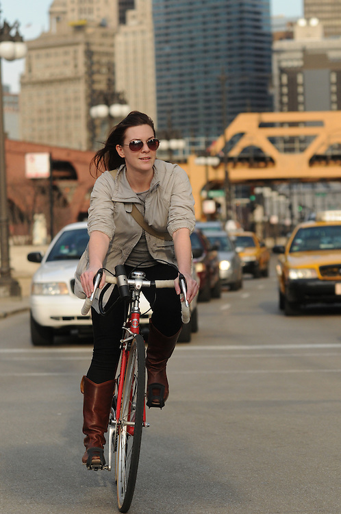 Biker Dana Hammett heads west on Wacker Drive during her commute home to Ukranian Village, a task she was once too intimidated to attempt. She now counts herself among the bike commuter crowd,  comfortable weaving among rush hour traffic. She even finds that a bike ride home can be faster than a car or public transportation at times.