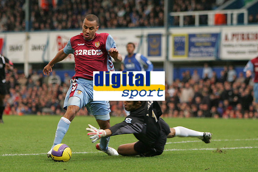 Photo: Lee Earle.<br /> Portsmouth v Aston Villa. The Barclays Premiership. 02/12/2006. Portsmouth keeper David James (R) brings down Gabriel Agbonlahor for a penalty.