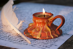 Document with quill and candle