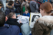 Tourists having their caricature portrait drawn by an artist in Leicester Square in London, England, United Kingdom.