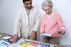 Decorator going through paint charts with his client,