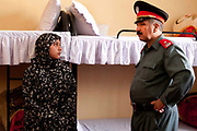 Afghanistan. Herat Women's prison. Prison governor with woman prisoner .