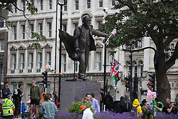 © Licensed to London News Pictures . 20/06/2015 . London , UK . Statue of David Lloyd George in Parliament Square . Tens of thousands of people march from the Bank of England to Parliament , to protest economic austerity in Britain . Photo credit: Joel Goodman/LNP