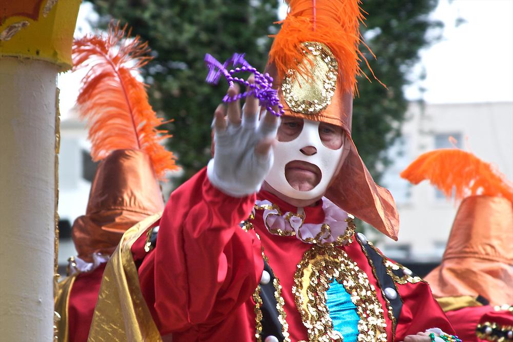 Rex Parade Rider Throwing Beads, Mardi Gras, New Orleans, Louisiana, USA