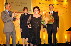 Left to right, MICHAEL BUERK, CHEY GARLAND Chief Executive of Garlands Call Centres winner of the 2005 Veuve Clicquot Award and CECILE BONNEFOND President Veuve Clicquot Ponsardin and JOHN WEST Veuve Clicquot Brand Manager at the 2005 Clicquot Award - Business Woman of The Year award ceremony held at Claridge's, Brook Street, London W1 on 28th April 2005.