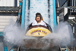 © Licensed to London News Pictures. 06/08/2020. Brighton, UK. Members of the public take a ride on an attraction on the Brighton Palace Pier in Brighton And Hove as sunny and hot weather is hitting the seaside resort. Photo credit: Hugo Michiels/LNP