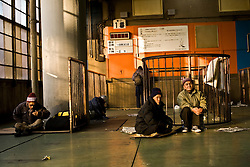 Homeless and unemployed gather at a labor center where people come to look for scarce jobs in Kamagasaki, Japan.