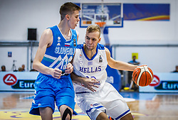 Scuka  Luka of Slovenia vs Kalogiros  Andreas of Greece during basketball match between National teams of Greece and Slovenia in the Group Phase C of FIBA U18 European Championship 2019, on July 29, 2019 in  Nea Ionia Hall, Volos, Greece. Photo by Vid Ponikvar / Sportida