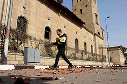 December 11, 2016 - Cairo, Cairo, Egypt - An Egyptian man walks outside the Saint Peter and Saint Paul Coptic Orthodox Church in Cairo's Abbasiya neighbourhood after it was targeted by a bomb explosion on December 11, 2016, . The blast killed at least 25 worshippers during Sunday mass inside the Cairo church near the seat of the Coptic pope who heads Egypt's Christian minority, state media said  (Credit Image: © Amr Sayed/APA Images via ZUMA Wire)