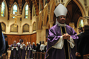 Chicago Auxiliary Bishop Joseph Perry joins a procession following a mass at Holy Name Cathedral promoting service leadership in the church for students and staff from Catholic high schools in the Archdiocese of Chicago and the Diocese of Rockford and Joliet. Behind Perry is Chicago Archbishop Francis Cardinal George
