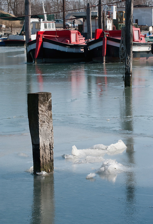 VENICE, ITALY - FEBRUARY 05:  Boats are blocked by ice in the North side of the frozen Venice Lagoon on February 5, 2012 in Venice, Italy. Italy as most of Europe is under a spell of very cold weather, it is more than 20 years aince the Venice Lagoon last froze.  (Photo by Marco Secchi/Getty Images)