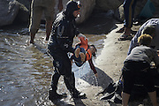 Oct. 15, 2015 - Lesbos Island, Greece - <br /> <br /> European Migrant Crisis<br /> <br /> Fatal Accident at sea caused at least nine deaths among migrants that in  thousands lands every day on the shores of the island of Lesbos from neighboring Turkey , distant only 4 nautical miles. Dead bodies are pulled out of the sea after greek coastguard vessel hits migrant boat. <br /> ©Exclusivepix Media