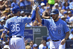 August 20, 2017 - Kansas City, MO, USA - Kansas City Royals' Mike Moustakas is greeted by Cam Gallagher after scoring on a single by Alcides Escobar in the second inning against the Cleveland Indians on Sunday, Aug. 20, 2017 at Kauffman Stadium in Kansas City, Mo. (Credit Image: © John Sleezer/TNS via ZUMA Wire)