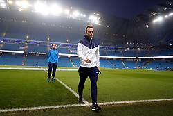 """Tottenham Hotspur's Christian Eriksen checks out the pitch before the Premier League match at the Etihad Stadium, Manchester. PRESS ASSOCIATION Photo. Picture date: Saturday December 16, 2017. See PA story SOCCER Man City. Photo credit should read: Martin Rickett/PA Wire. RESTRICTIONS: EDITORIAL USE ONLY No use with unauthorised audio, video, data, fixture lists, club/league logos or """"live"""" services. Online in-match use limited to 75 images, no video emulation. No use in betting, games or single club/league/player publications."""