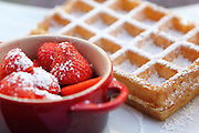 Waffles with strawberries at a café in Antwerp, Belgium