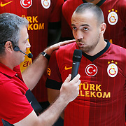 Turkish soccer team Galatasaray players Sercan Yildirim (R) pose during the presentation of the new uniform at the TT Arena in Istanbul Turkey on Wednesday, 18 July 2012. Photo by TURKPIX
