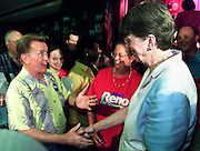 """Actor Martin Sheen (L) greets Janet Reno (R) during a campaign stop in Deerfield Beach, Florida, June 8, 2002. Sheen, who plays the U.S. president on """"The West Wing"""" television show, is helping the former U.S. Attorney General during a four-day campaign and fund-raising tour around Florida. Reno is favored to become the Democratic gubernatorial candidate in September. If she wins she will go up against U.S. President George W. Bush's brother, Republican incumbant Jeb Bush in a November election. REUTERS/Colin Braley"""