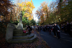 © Licensed to London News Pictures. 11/11/2012. Whitchurch-on-Thames, Reading, Berkshire. Harry Butterworth, Chairman of Whitchurch-on-Thames Parish Council lays a wreath at the Whitchurch Hill Memorial. Local people of the Parishes of Whitchurch-on-Thames and Goring Heath gathered at the War Memorial to remember the fallen on Remembrance Sunday, at a Memorial Service. Rev Claire Alcock took the service in amongst the autumnal beech trees at the memorial purposely built between the two parishes. Photo credit : Rebecca Mckevitt/LNP