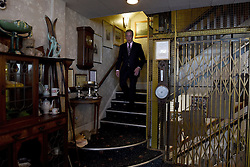 """© London News Pictures. """"Looking for Nigel"""". A body of work by photographer Mary Turner, studying UKIP leader Nigel Farage and his followers throughout the 2015 election campaign. PICTURE SHOWS - UKIP leader Nigel Farage descends the stairs of the Walpole Bay Hotel where he spent the night of the country's election count, before heading to the Thanet South count at the Winter Gardens in Margate, Kent on 8th May 2015. Knowing already that he had failed in his bid to win the seat, as he left the hotel Mr Farage told reporters that he had had the best night's sleep he had had in a long time. . Photo credit: Mary Turner/LNP **PLEASE CALL TO ARRANGE FEE** **More images available on request**"""