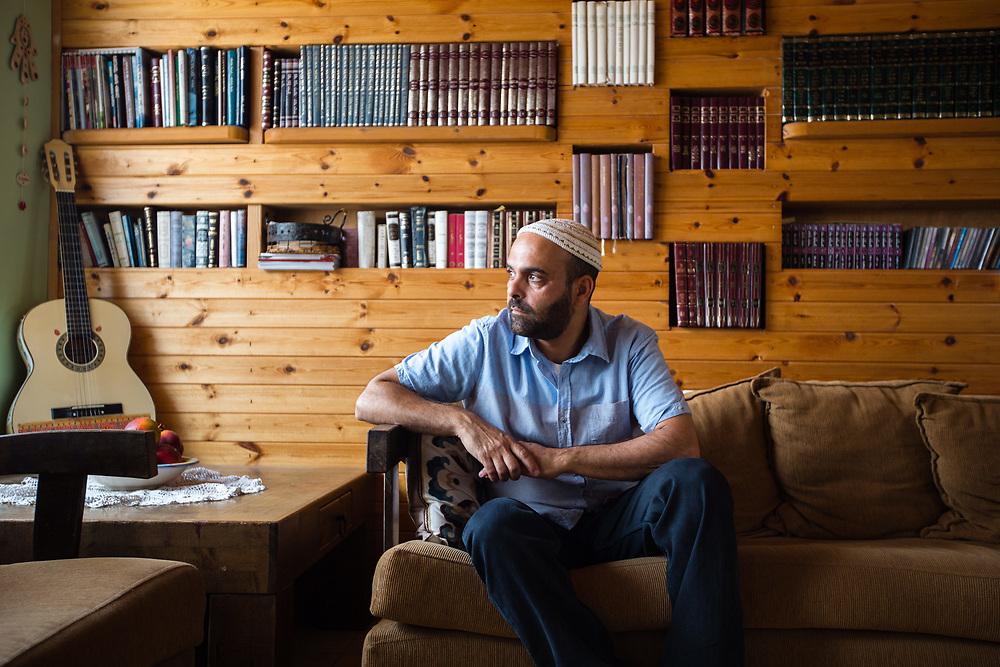 Ezri Tubi, spokesman for the Jewish settlement of Yitzhar, poses for a portrait at his house in the West Bank Jewish settlement of Yitzhar, south of the Palestinian West Bank city of Nablus, on August 5, 2015.