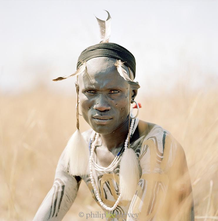 Mursi tribal man wearing traditional headdress, Omo Valley, Southern Ethiopia.