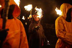 © Licensed to London News Pictures. 06/02/2016. Marsaden, UK. Hooded figures carry flaming torches during the spectacular Imbolc fire festival in Marsden, West Yorkshire, UK.Based on ancient pagan traditions,  Imbolc is a Gaelic festival celebrating the end of winter and the coming of spring. The focal point of the event is the face-off between the Green Man, who represents the coming spring, and Jack Frost, winter - with the former coming out on top. Photo credit : Ian Hinchliffe/LNP