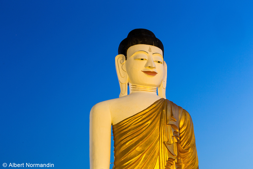 Sitting Buddha statue with light and blue sky, Chauk