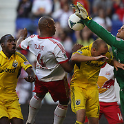Columbus goalkeeper Andy Gruenebaum blocks a close range header from Jamison Olave, New York Red Bulls with the help of Columbus defender Eric Gahrig and Tony Tchani, (left) during the New York Red Bulls V Columbus Crew, Major League Soccer regular season match at Red Bull Arena, Harrison, New Jersey. USA. 26th May 2013. Photo Tim Clayton