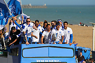 Brighton players on open top bus sing along with fans during the Brighton & Hove Albion Football Club Promotion Parade at Brighton Seafront, Brighton, East Sussex. United Kingdom on 14 May 2017. Photo by Ellie Hoad.