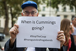 London, UK. 2 September, 2019. A man holds a sign asking 'When is (Dominic) Cummings going' at a 'Stop the Coup' protest attended by hundreds of people in Whitehall as Prime Minister Boris Johnson makes an address to the nation outside 10 Downing Street to the effect that there will be a vote on a general election if MPs vote for a further delay to Brexit.
