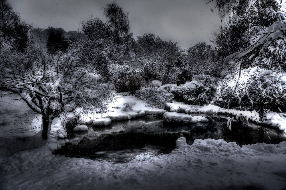 Pond in wintry snow landscape