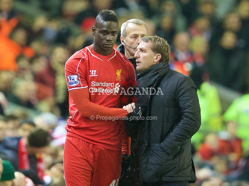 LIVERPOOL, ENGLAND - Monday, December 29, 2014: Liverpool's manager Brendan Rodgers prepares to bring on substitute Mario Balotelli against Swansea City during the Premier League match at Anfield. (Pic by David Rawcliffe/Propaganda)
