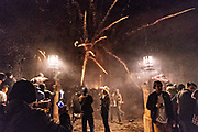 A group of onlookers watch a barrage of sky rockets explode from relative safety during the Alborada festival September 29, 2018 in San Miguel de Allende, Mexico. The unusual festival celebrates the cities patron saint with a two hour-long firework battle at 4am representing the struggle between Saint Michael and Lucifer.