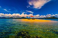 Couple enjoy the seclusion of a sandbar near the Nukubati Island Resort, Fiji Islands