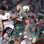 Besiktas's Ersan Adem Gulum (L) and CaykurRizespor's Remzi Giray Kacar (C) Leony Leonard Kweuke (R) during their Turkish superleague soccer match Besiktas between CaykurRizespor at Ataturk Olimpiyat Stadium in Istanbul Turkey on Monday 15 September 2014. Photo by Aykut AKICI/TURKPIX