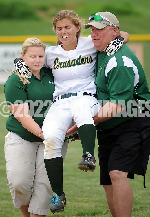 LYONS, PA - JUNE 09: Lansdale Catholic's Kristin Szczepaniak (C) is carried off the field by Silvia Sokol (L) and assistant coach Frank Rose (R) in the late in the game during the PIAA Class AAA softball semifinal June 9, 2014 Lyons, Pennsylvania. Bethlehem won 4-1. (Photo by William Thomas Cain/Cain Images)
