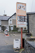 An old patrol station sign for British Fuels displays the prices for unleaded petrol and derv, on 7th October 2021, in Portmadoc, Gwynedd, Wales.